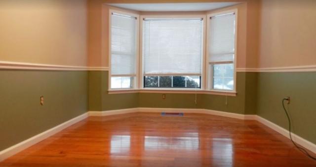 room design with hardwood floors custom trimwork and cellular shades